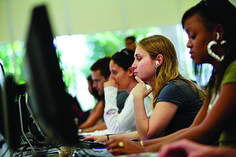 Students reading in a computer lab