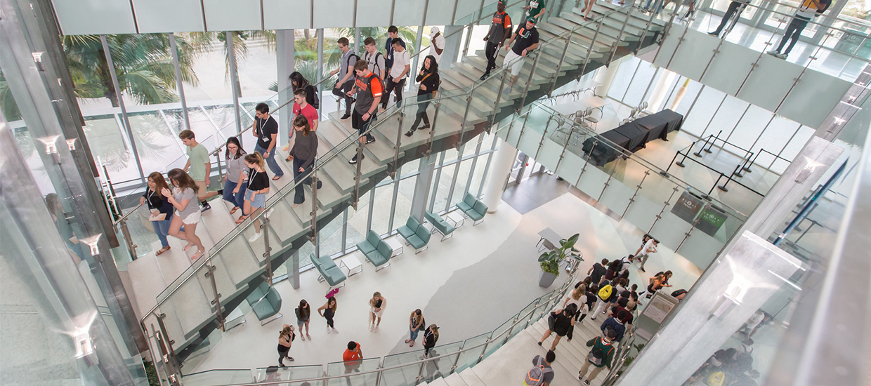 Students using the stair case in the Shalala Student Center