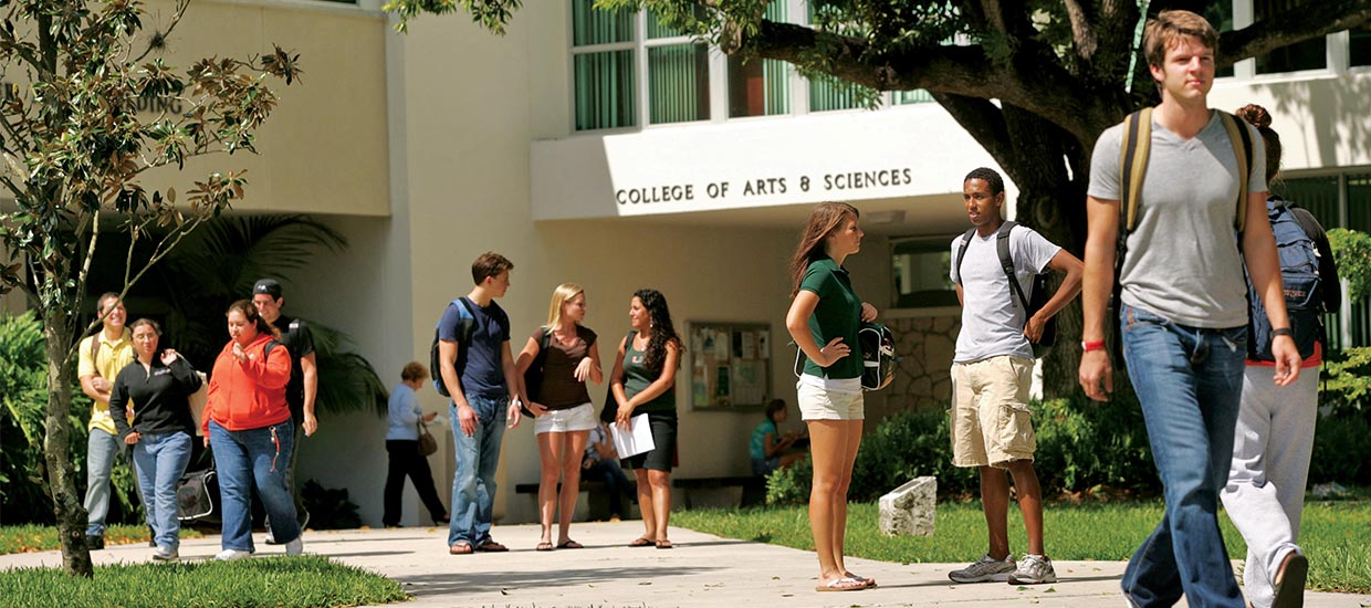 Students walking and socializing outside of the College of Arts and Sciences and Ashe buildings